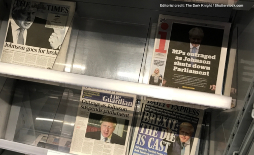 Newsstand showing newspapers with headlines about Boris Johnson: Credit: The Dark Knight/Shutterstock